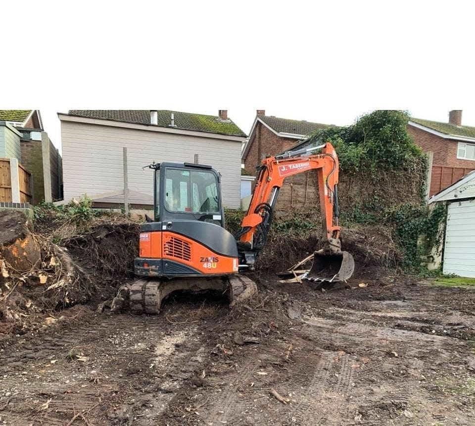 Mini Digger Hire Burton on Trent Mini digger clearing ground